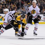 Chicago Blackhawks center Marcus Kruger (16) collides with Boston Bruins defenseman Dougie Hamilton (27).