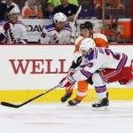 NHL 2015 - Sept 22 - NYR vs PHI - Center Travis Konecny (#80) of the Philadelphia Flyers passes the puck against Left Wing Ryan Bourque (#29) of the New York Rangers