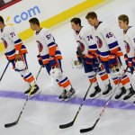 Members of the New York Islanders lineup on the blue line during the national anthem