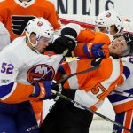Left Wing Ross Johnston (#52) of the New York Islanders lands a blow against Defenseman Travis Sanheim (#57) of the Philadelphia Flyers