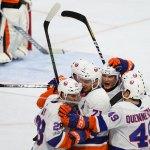 Members of the New York Islanders celebrate a goal scored