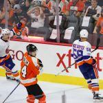Center Scott Eansor (#36) of the New York Islanders celebrates the game ending goal scored by teammate Defenseman Mitchell Vande Sompel (#58)