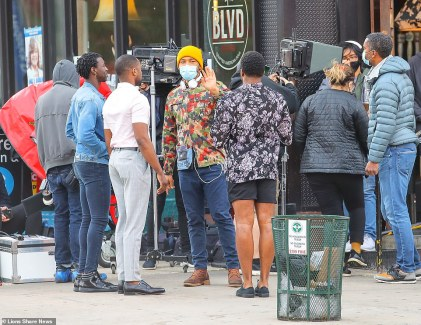 34626748-8860369-Smollett_38_was_seen_wearing_a_a_mask_with_headphones_around_his-a-86_1603214295044
