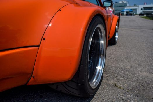 Wide Toyo R888 tires and AutoArt wheels are tucked inside the widebody fender flares of the Porsche 934.