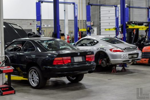 BMW 850 and Porsche Cayman on lifts at Engineered Automotive