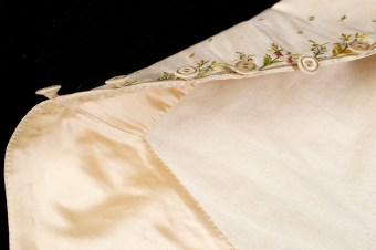 The front of the waistcoat is finished with deep facings of silk satin similar to those of the coat.