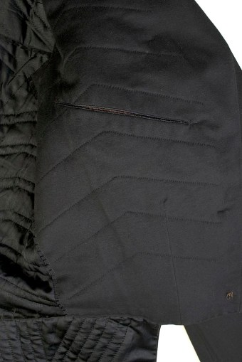 The interior padding in this coat serves to round out the suit into the desired silhouette. There is a pocket concealed in the inside of the jacket.