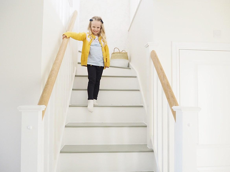 child walking down stairs