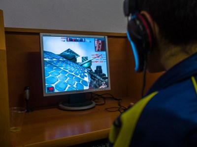 A Turkish child in an internet cafe not far from the Syrian school plays war games on a computer.