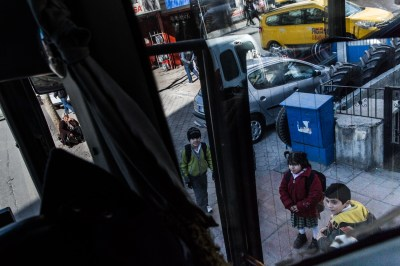 Students from the Friendship School getting off the bus after school in Gaziantep, by Mieke Strand