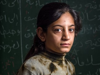 Syrian refugee girl in a school in Beirut supported by the Jesuit Refugee Service.
