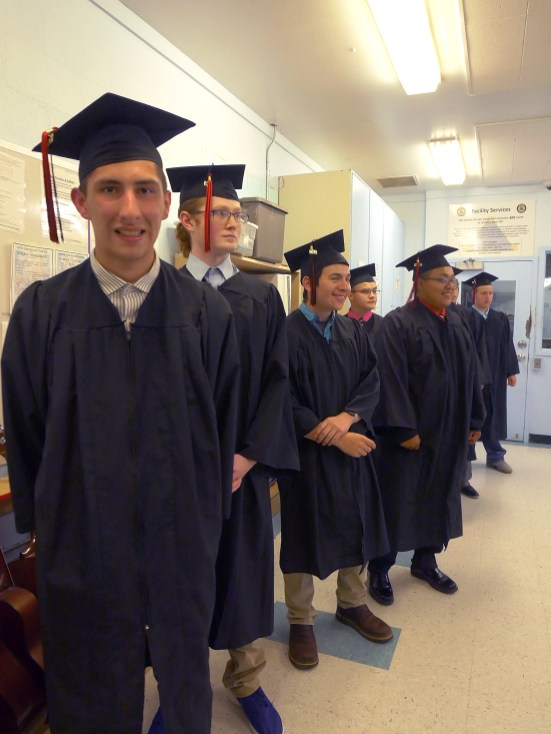 Timothy R. and his graduating classmates line up outside the gymnasium where their Trask River High School graduation was held on June 21.