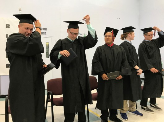 Trask River High School graduates move their tassels from the right to the left after receiving their diplomas.