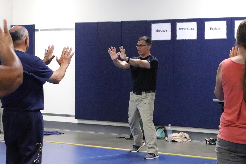 Trainer Ed Thomas models a self-defense pose to a group of teachers during New Employee Orientation at the OYA Training Academy.