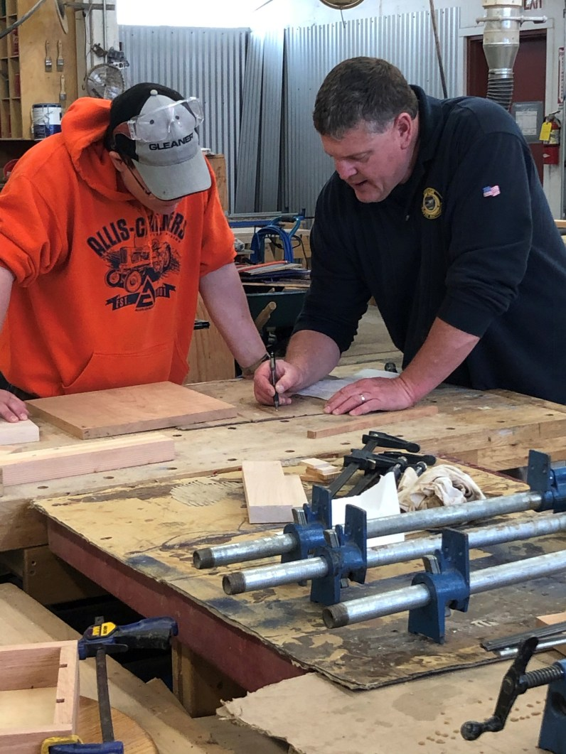 Steve Bodine works with a youth in the woodshop at Tillamook YCF.