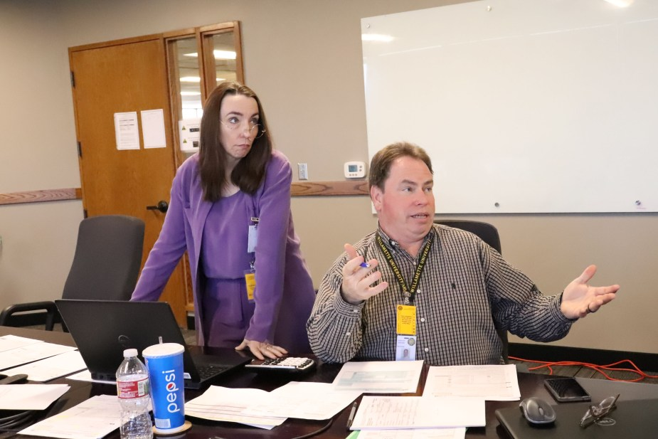 two Revenue employees talk during a session