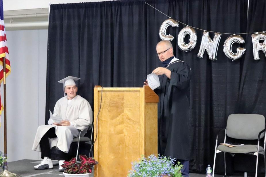 valedictorian and principal on graduation stage