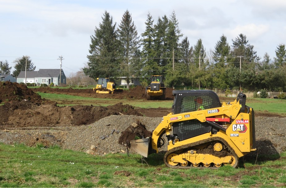 a big machine pushing dirt outside