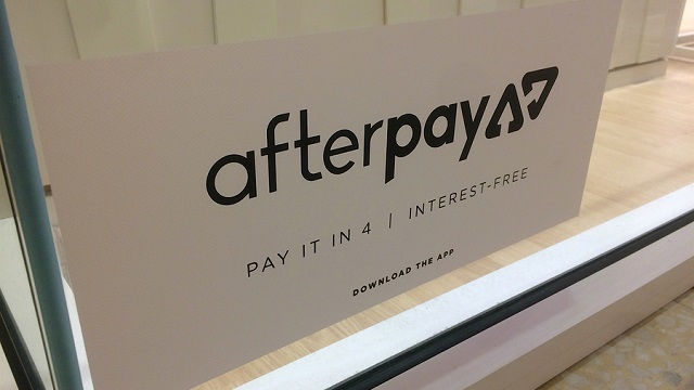 Afterpay App sticker placed on a shopfront window at the Sunshine Plaza Mall.
