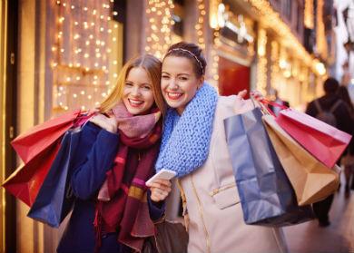 two-girls-shopping-bags-390x279
