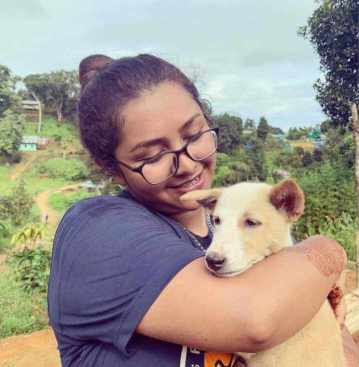 Prosun Azad with her Dog