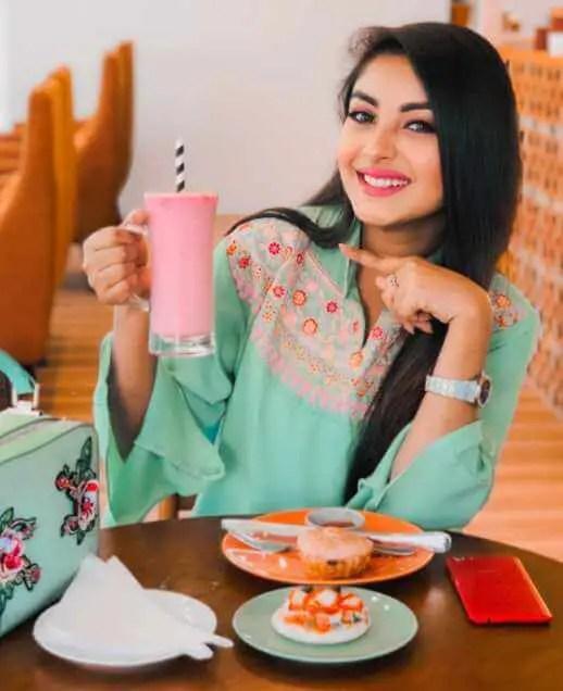 Nusrat Jahan Ontora with foods Image