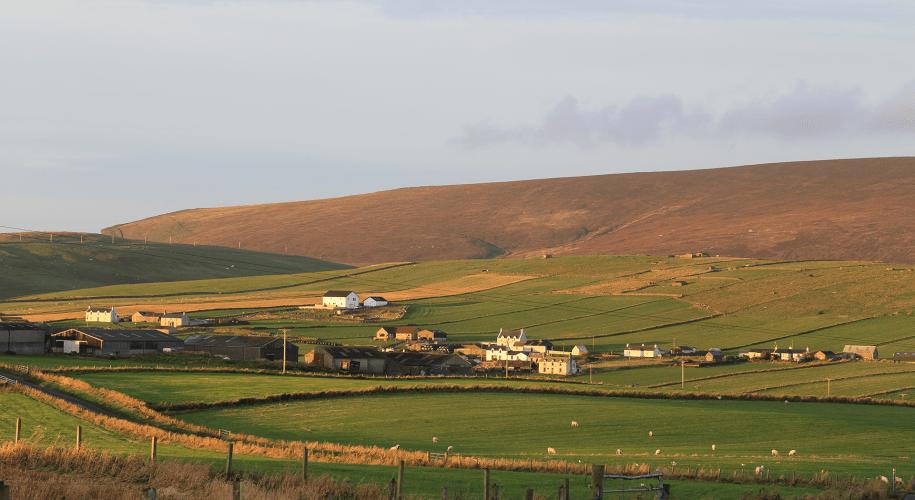 A view across farmland and Hillwell to Fitful Head, south Mainland, Shetland, Scotland, UK.