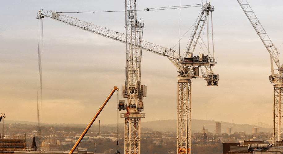 Large cranes with Edinburgh skyline