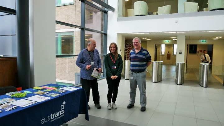 Sustrans colleagues at table with information leaflets