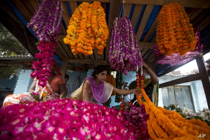 Vendors sell marigold flower garlands, commonly used to decorate homes and perform rituals, during Diwali festival in Allahabad…