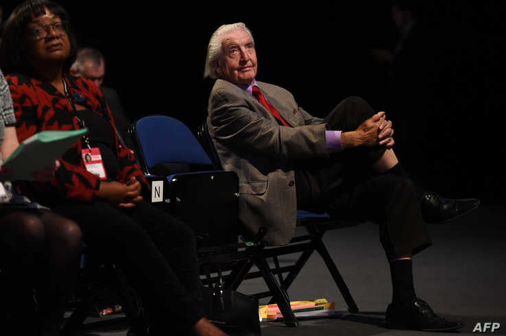 FILE - Labour party MP Dennis Skinner listens to a speech at a Labour party conference in Liverpool, England, Sept. 25, 2018.