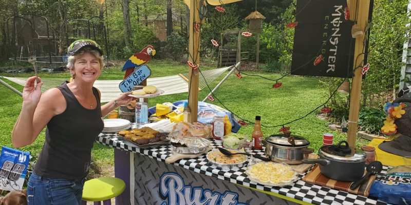 tailgate food and setup by NASCAR fans in backyard