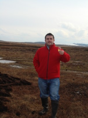 andre in islay with whisky