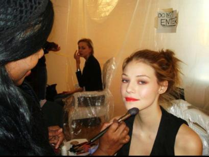 Celebrity Makeup Artist Brandy Gomez-Duplessis doing makeup at NYFW