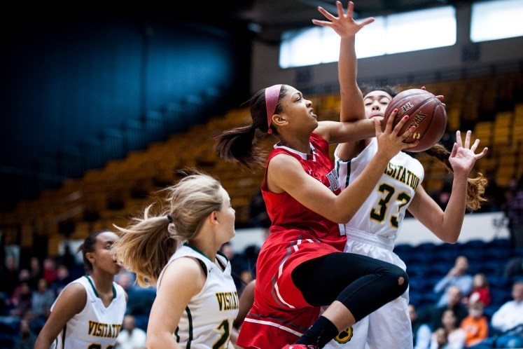 WASHINGTON, DISTRICT OF COLUMBIA - MARCH 6: St. John's Kayla Robbins drives to the basket against Georgetown Visitation during first quarter action in the D.C. State Athletic Association basketball championships at the George Washington University's Smith Center on Sunday, March 6, 2016 in Washington, District of Columbia. St John's won the game 59-47. (Photo by Pete Marovich For The Washington Post)