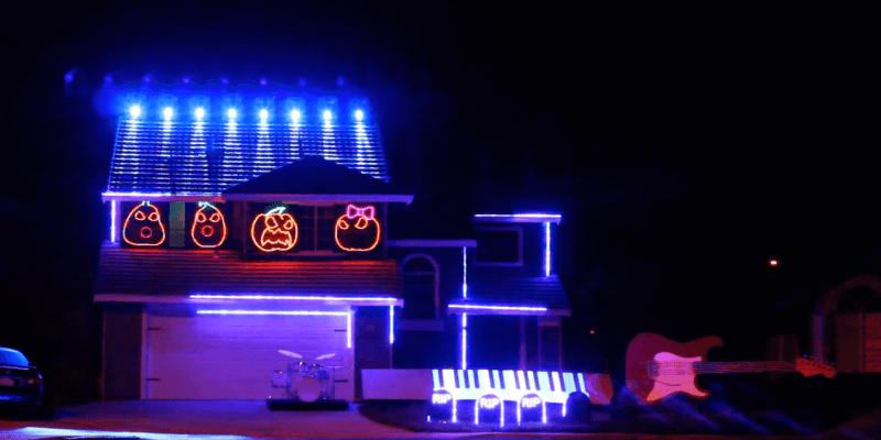 video halloween light show display with best disney villains songs