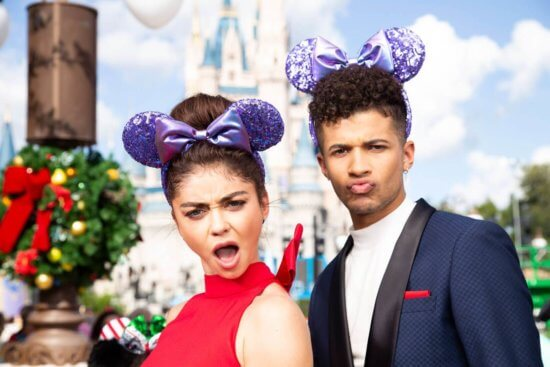 Sarah Hyland and Jordan Fisher wearing Purple Potion Minnie Ears