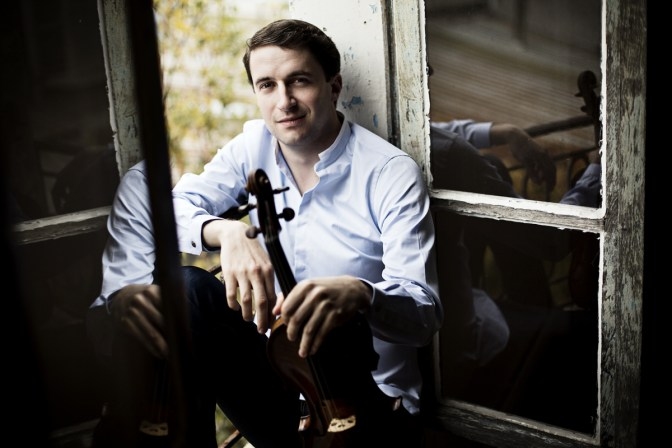 Noah Bendix-Balgley headshot sitting inside a window.