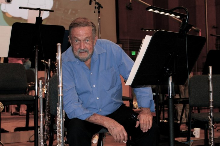 Sheridan Stokes in the studio sitting with his flutes while taping the Family Guy
