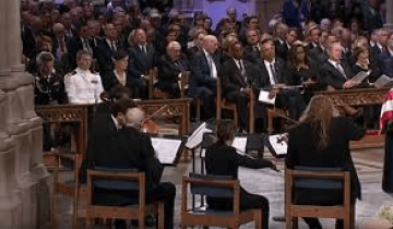 tv snapshot of John McCain's funeral, picture of string quartet where Edwin Huizinga is one of the performers.