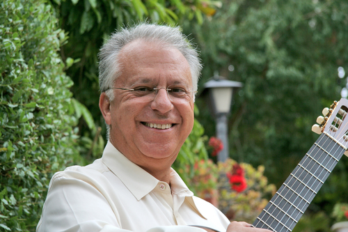 guitarist Pepe Romero posing with guitar