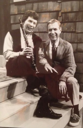 Richard Stoltzman sitting on the steps with Fred Rogers after taping an episode of Mr Rogers Neighborhood.