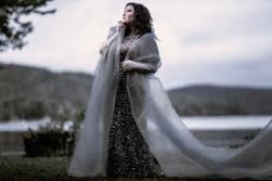 Jamie Barton's album cover, posing outside with a long silver dress