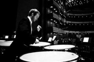 Jason Haaheim in a tuxedo preparing a timpani to perform at the Metropolitan Opera