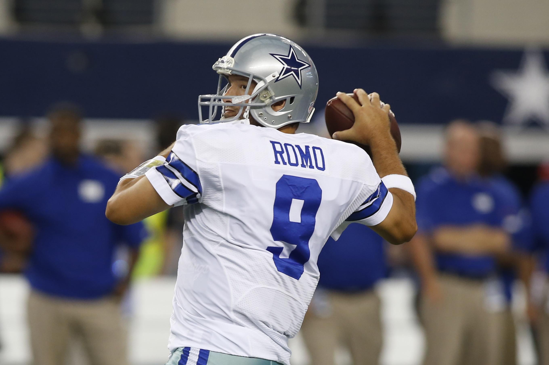 Quarterback Tony Romo of the Dallas Cowboys celebrates a