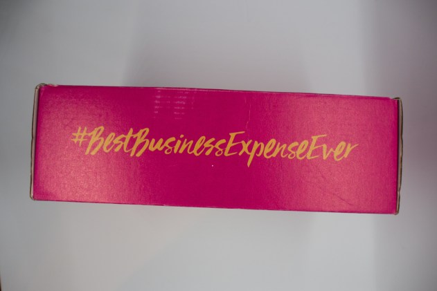 Pink box with #BestBusinessExpenseEver written in gold on the side.