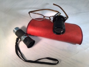 Monocular telescopes. Hand-held, with strap, and clip-om mounted on eyeglasses
