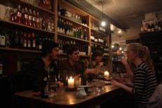 A group of students enjoys a bite to eat and sips on glasses of wine at one of the most popular cafes in downtown Arhus. This café in particular is also a bookshop and is known for its cozy atmosphere.