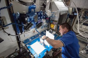 Expedition 36 industrial engineer Chris Cassidy of NASA works on the Capillary Flow Experiment aboard the International Space Station on May 22 (NASA)