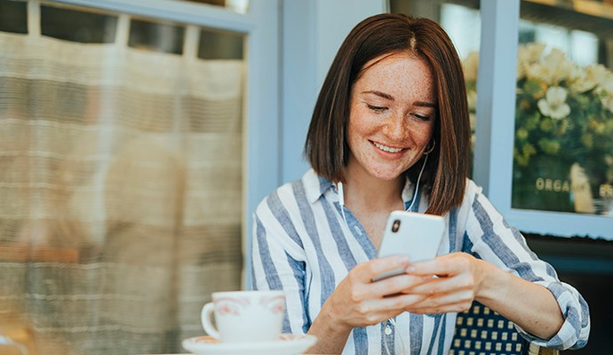 Woman signing up using digital onboarding.